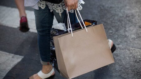 Shopper with a shopping bag