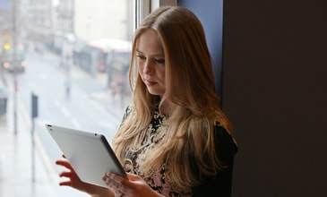Woman reading using a tablet